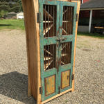 Spalted maple wine cabinet with antique doors
